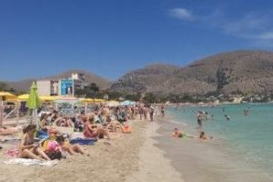 Palermo, Mondello beach at the shore in summer time, facing West