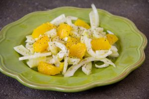 sliced fennel and cut up orange, a drizzle of oil and a sparkle of oregano; wonderful winter salad