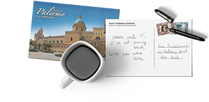 a postcard, a cup of coffee and a pen for the contact page