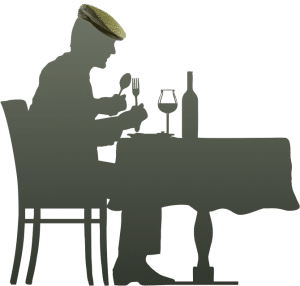 silhouette of a man eating, wearing a typical Sicilian Coppola