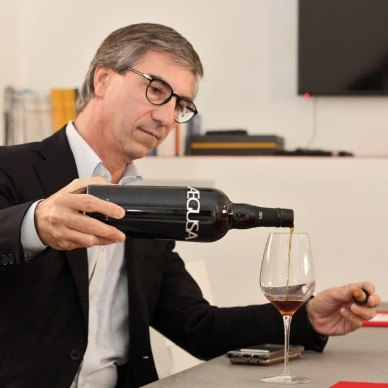 Luigi Salvo pouring wine