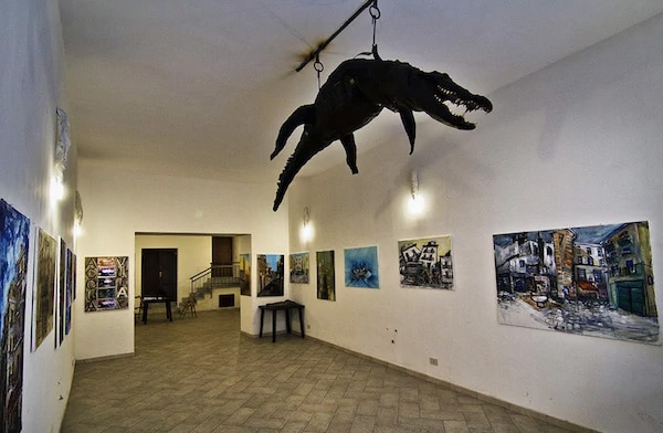 the crocodile, hanging from the ceiling