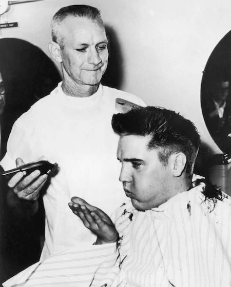 Elvis having his hair cut