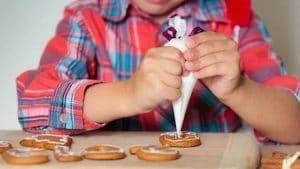 boy making biscuits