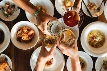 people toasting over a nice meal