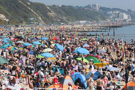 a busy beach in summertime